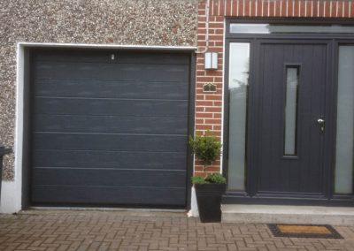 Image of front house with main door and garage door